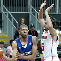 04 August 2012: France Nicolas Batum looks to pass Tunisia Marouan Laghnej during 73-69 Team France victory over Team Tunisia, during the men's basketball preliminary, at the Basketball Arena, in London, Great Britain.