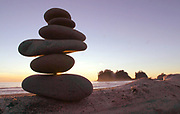 This stack of beach stones complements nature's art as sunset embraces First Beach near La Push. (Tom Reese / The Seattle Times, 2002)