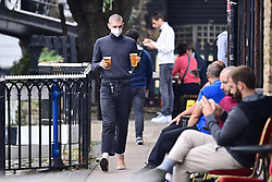 © Licensed to London News Pictures. 24/09/2020. London, UK. Members of the public are seen enjoying a drink at a pub in Camden, North London on the first day that pubs will be forced to close at 10pm in order to prevent the spread of COVID-19. Chancellor Rishi Sunak today outlined a series of financial packages to help business through new lockdown measures. Photo credit: Ben Cawthra/LNP