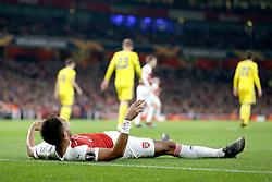 Arsenal's Pierre-Emerick Aubameyang lies on the pitch
