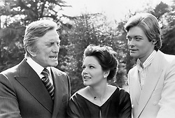 File photo dated 14/06/77 of (left to right) Kirk Douglas, Agostina Belli and Simon Ward during the filming of Holocaust 2000. Douglas is celebrating his 100th birthday today.