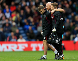 James Collins of West Ham United is helped from the pitch after picking up an injury - Mandatory by-line: Paul Roberts/JMP - 16/09/2017 - FOOTBALL - The Hawthorns - West Bromwich, England - West Bromwich Albion v West Ham United - Premier League