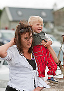 Kim and young Rex Scott,Dooras watching the Galway Hookers at the Crinniú na mBad,Kinvara,Co Galway at the weekend. Photograph by Eamon Ward