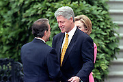 US President Bill Clinton welcomes Colombian President Andres Pastrana during an arrival ceremony on the South Lawn of the White House October 28, 1998 in Washington DC.