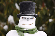 A snowman is frosted with freezing rain in Portland's Sellwood neughborhood Sunday morning.