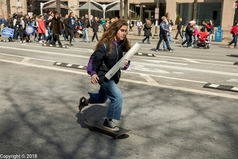 032418 - Washington, D.C., USA: Young woman on a skateboard. Protesters participate in the March for Our Lives rally on March 24, 2018 in Washington D.C. More than 800 March for Our Lives events, organized by survivors of the Parkland, Florida school shooting on February 14 that left 17 dead, are taking place around the world to call for legislative action to address school safety and gun violence. Organizers estimated that approximately 800,000 people attended the rally in Washington, D.C. (Jeremy Hogan/Polaris)