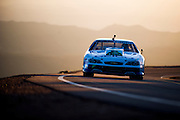 June 26-30 - Pikes Peak Colorado. Layne Schranz runs his car during practice for the 91st running of the Pikes Peak Hill Climb.