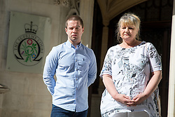 "© Licensed to London News Pictures. 08/05/2018. London, UK. Sam Hallam arriving at the Supreme Court with his mother Wendy Cohen, where he is appealing for ""miscarriage of justice"" compensation. Hallam spent over seven years in jail after he was wrongly sentenced to life in 2005 for a gang-related murder in north London that he did not commit. Photo credit : Tom Nicholson/LNP"