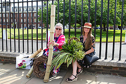 May 25, 2019 - London, UK, United Kingdom - Visitors to the RHS Chelsea Flower Show seen seated while holding different plants and flowers during the final day of the show..The Royal Horticultural Society Chelsea Flower Show is an annual garden show held in the grounds of the Royal Hospital Chelsea in West London since 1913. (Credit Image: © Dinendra Haria/SOPA Images via ZUMA Wire)