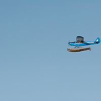 A float plane flies over Lake of the Woods, Ontario, Canada.