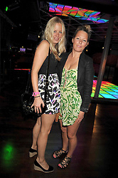 Left to right, sisters ASTRID HARBORD and DAVINA HARBORD at the launch party of the new Embargo 59 nightclub at 533 Kings Road, London on 25th June 2009.