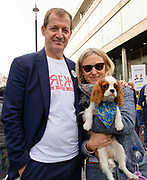Alastair Campbell, his partner Fiona Millar and their dog Skye join pet owners to take part in an anti Brexit Wooferendum rally on October 07, 2018 in London, England to protest against Britain leaving the European Union.