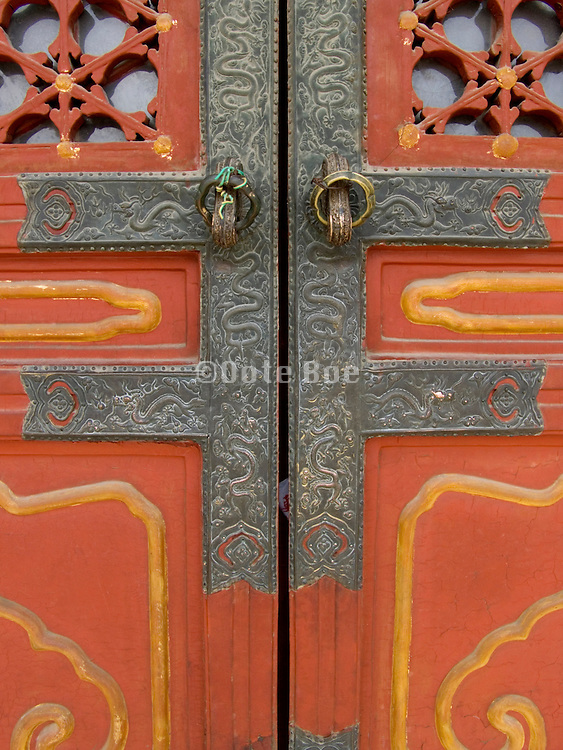 closed door with ornamental design within the forbidden city in Beijing China