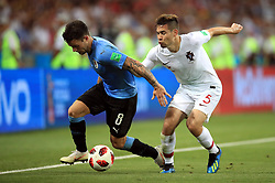 Uruguay's Nahitan Nandez (left) and Portugal's Raphael Guerreiro battle for the ball