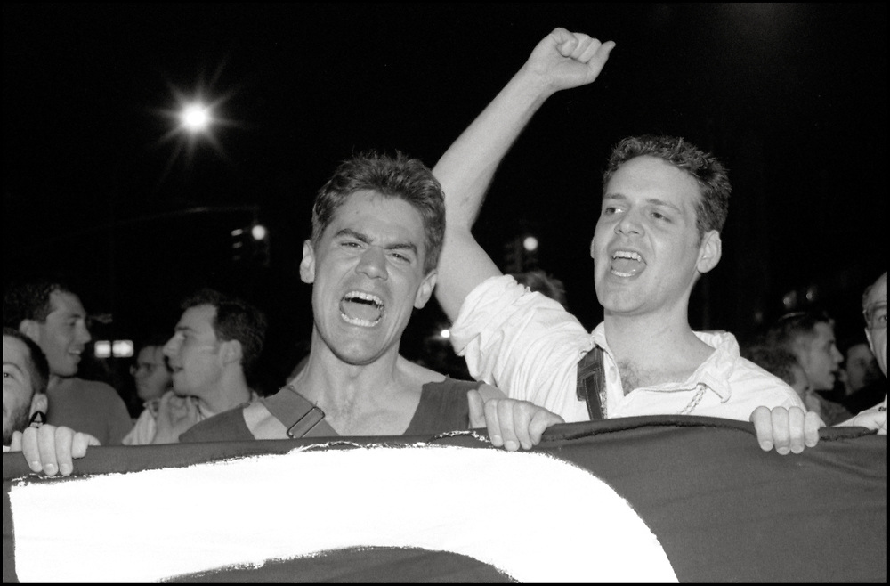 On April 28th, 1990, a pipe bomb exploded at a crowded gay bar, Uncle Charlie's, in New York City. Three people were injured. The following night 1500 people marched through the West Village to express their concern over the increasing incidence of violence directed at gay people and their outrage that the bombing was not designated a bias-related crime.<br /> <br /> Walter Armstrong and Michael Perelman, Michael Goff, Jeffrey John Fennelly pictured.