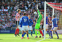 Carlisle United's Jack Bonham denies Lincoln City's Sean Raggett from close range<br /> <br /> Photographer Chris Vaughan/CameraSport<br /> <br /> The EFL Sky Bet League Two - Lincoln City v Carlisle United - Saturday 26th August 2017 - Sincil Bank - Lincoln<br /> <br /> World Copyright © 2017 CameraSport. All rights reserved. 43 Linden Ave. Countesthorpe. Leicester. England. LE8 5PG - Tel: +44 (0) 116 277 4147 - admin@camerasport.com - www.camerasport.com
