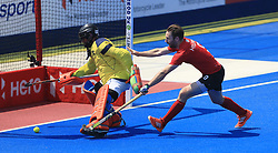 Scotland's Thomas Alexander (left) and Canada's Richard Hildreth battle for the ball during the Men's World Hockey League match at Lee Valley Hockey Centre, London.
