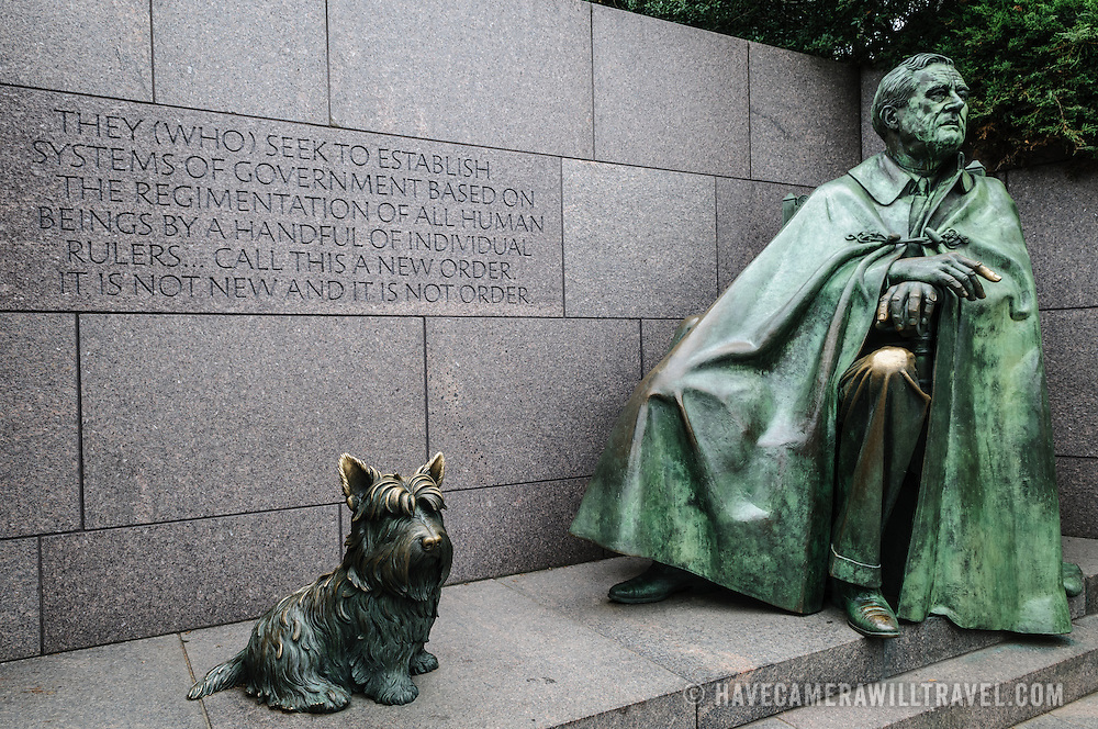 Bronze statue of President Franklin D. Roosevelt and his terrier at the Franklin D. Roosevelt Memorial in Washington DC on Haines Point on the banks of the Tidal Basin