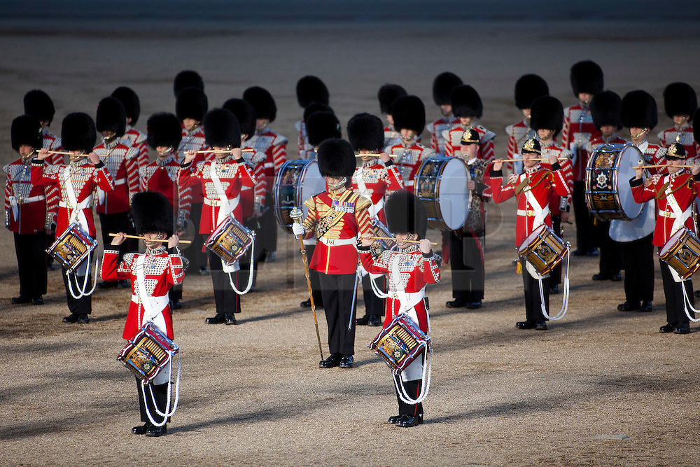 © Licensed to London News Pictures. LONDON, UK  08/06/11. .Bandsmen of the Guards Division pause before leaving Horse Guards Parade as they take part in the opening night of the Beating the Retreat ceremony. This year the opening night of Beating the Retreat took place with the American Ambassador receiving the salute. The traditional parade, involving all of the bands of the Household Division of the British Army, dates back to times when, after a day's battle, troops would retreat for the night.  Please see special instructions for usage rates. Photo credit should read Matt Cetti-Roberts/LNP