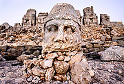 Statue of Zeus.<br /> South-eastern Anatolia, Nemrut Dagi national park. The enigmatic statues that stand on the top of Mount Nemrut have become the symbol of Turkey.<br /> This is the mountain where more than 2000 years ago King Antioco I had himself buried under an inviolate artificial mound, at an altitude of 2150m, at the sides of the mound there are two terraces there are five colossal divinities; to the west Apollo, the goddess Fortuna, Jupiter, Hercules and Antiochus. The heads fell with an earthquake and now lie at the foot of the statues.<br /> Turkey, August 2006<br /> <br /> Photo Antonietta Baldassarre Inside
