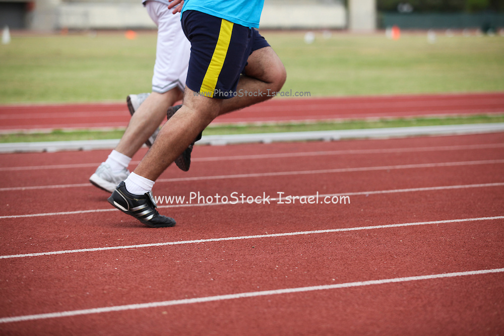 lower half of runners on a race track