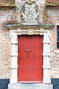 Traditional door and doorway painted bright red in old town Bruges - Brugge - Belgium