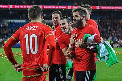 Gareth Bale of Wales celebrates with Joe Ledley and Aaron Ramsey - Mandatory byline: Dougie Allward/JMP - 07966 386802 - 13/10/2015 - FOOTBALL - Cardiff City Stadium - Cardiff, Wales - Wales v Andorra - European Qualifier 2016 - Group B