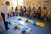 Daryl, a retired nurse, teaches CPR, basic life support and first aid skills in a hospital clinic in Johannesburg, South Africa.  Daryl is a volunteer from Bigshoes Foundation, a charity that provides medical care and interventions to children living in children's homes and those who have been adopted both in the community and in hospital.  Workers from various children's care homes in Guateng state attend this training.