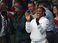 Sister Serena claps after Venus Williams wins her Semi-Final against Kim Clijsters, father Richard takes photos. Wimbledon Tennis Championship, Day 10, 3/07/2003. Credit: Colorsport / Matthew Impey DIGITAL FILE ONLY