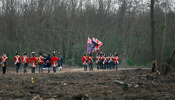 11 January 2015. New Orleans, Louisiana. <br /> Bicentennial reenactment of the Battle of New Orleans in Chalmette. <br /> British troops retreat as they re-enact their disastrous January 8th, 1815 battle against American foes marking the 200th anniversary of the Battle of New Orleans in Chalmette. Despite heavily outnumbering the Americans, the British suffered over 2,000 casualties, with many senior officers amongst the dead and injured compared to the Americans who suffered a mere 70 by comparison. The American victory was hailed as miracle.<br /> Photo; Charlie Varley/varleypix.com