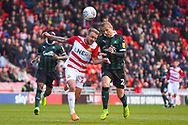 James Coppinger of Doncaster Rovers (26) and Oscar Threlkeld of Plymouth Argyle (26) in action during the EFL Sky Bet League 1 match between Doncaster Rovers and Plymouth Argyle at the Keepmoat Stadium, Doncaster, England on 13 April 2019.