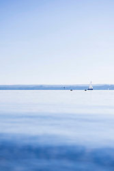 Yacht horizon sunrise mist distant seascape