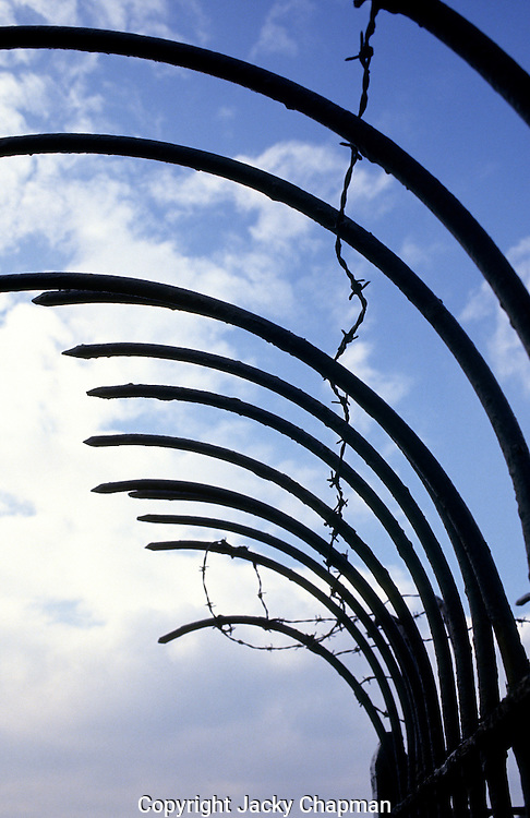 High security fencing with barbed wire