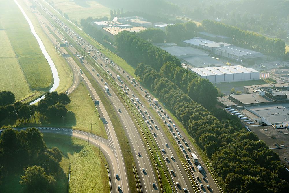Nederland, Utrecht, Baarn, 28-10-2014; file in de vroege ochtend op de A27, knooppunt Eemnes.<br /> Early morning traffic congestion.<br /> <br /> luchtfoto (toeslag op standard tarieven);<br /> aerial photo (additional fee required);<br /> copyright foto/photo Siebe Swart