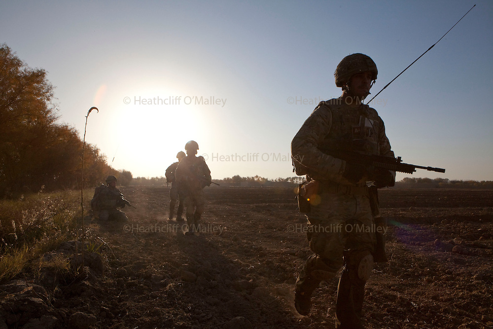 Mcc0027461 . Daily Telegraph..Paratroopers from A coy, 3 Para under the command of Lt Jamie Macdonald on patrol south of their base CP Qudtrat in the northern Nad e Ali district of Helmand. ..Helmand 2 December 2010