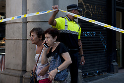 BARCELONA (SPAIN), Aug. 17, 2017  People are evacuated from Plaza Catalonia following a terrorist attack in central Barcelona, Spain, on Aug. 17, 2017. Thirteen people were killed, 80 others injured and hospitalized with 15 of them in serious condition in Barcelona terrorist attack on Thursday afternoon, Spanish official said. (Credit Image: © Lino De Vallier/Xinhua via ZUMA Wire)