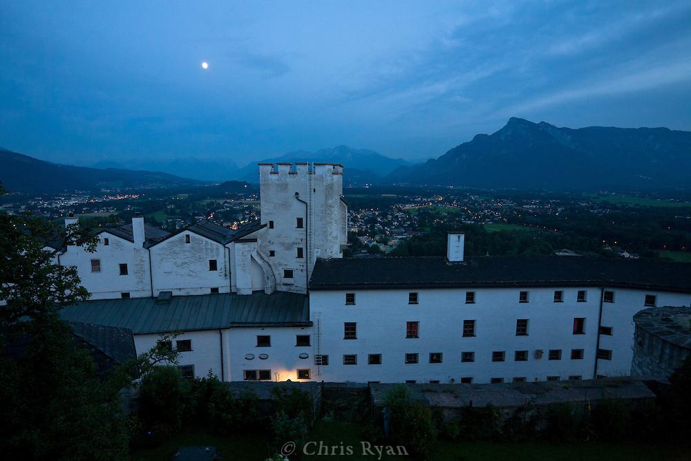 Hohensalzburg Castle at night with Austrian Alps in background, Salzburg, Austria