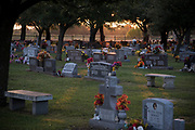 WEST, TEXAS - APRIL 14:  The sun sets behind St Mary's Catholic Cemetery in West, Texas on April 18, 2017. (Photo by Cooper Neill for The Washington Post)
