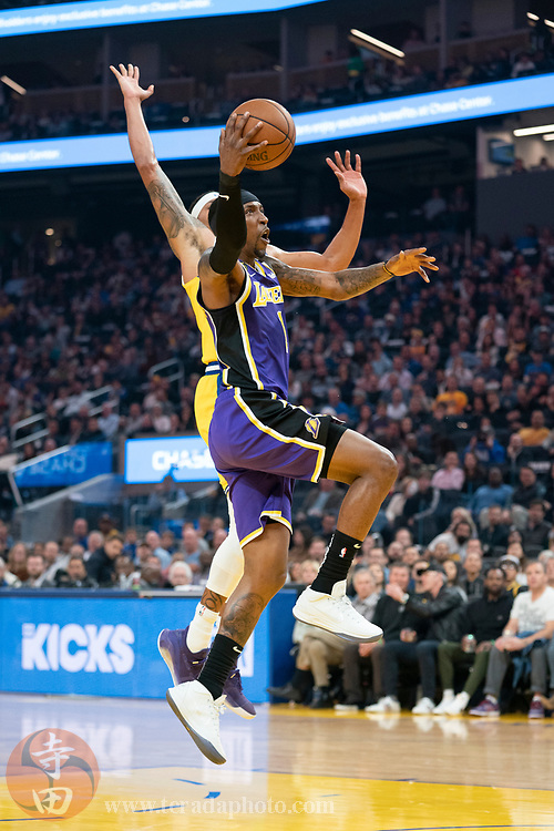 February 27, 2020; San Francisco, California, USA; Los Angeles Lakers guard Kentavious Caldwell-Pope (1) shoots the basketball against Golden State Warriors guard Damion Lee (1) during the first quarter at Chase Center.