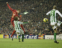 Photo: Aidan Ellis.<br /> Liverpool v Real Betis. UEFA Champions League.<br /> 23/11/2005.<br /> Liverpool's Peter Crouch fires in a shot that hits Betis David Rivas on the arm but no penalty was given