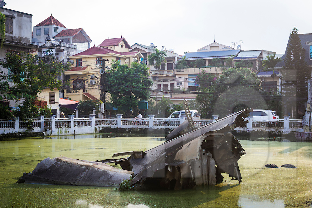 Remains of a B52 bomber shot down during the American War lie in the B52 lake in Hanoi, Vietnam, Asia