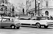 mini & stretch. Piccadilly Circus. London September 1996<br /> Copyright Photograph by Dafydd Jones<br /> 66 Stockwell Park Rd. London SW9 0DA<br /> Tel. 0171 733 0108