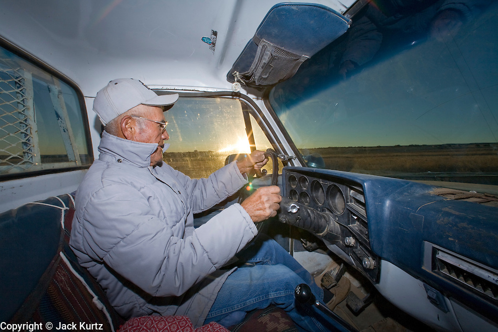 22 OCTOBER 2007 -- COYOTE CANYON, NM: MARK TSOSIE, 78 years old, a member of the Navajo Nation, drives about 30 miles a day to haul water from a well to his home and his livestock. Tsosie has been hauling water all his life. He started working for the railroad when he was 14 years old. His job was to haul water to the workers. Now retired and he's still hauling water except now he hauls it to his home. More than 30 percent of the homes on the Navajo Nation, about the size of West Virginia and the largest Indian reservation in the US, don't have indoor plumbing or a regular supply of domestic water. Many of these homes have to either buy water from commercial vendors or haul water from public wells. A Federal study showed that the total cost of hauling water was about $113 per 1,000 gallons. A Phoenix household, in comparison, pays just $5 a month for up to 7,400 gallons of water. The lack of water on the reservation means the Navajo are among the most miserly users of water in the United States. Families that have to buy or haul water use only about 15 gallons of water per day per person. In Phoenix, by comparison, the average water use is about 170 gallons per day.  Photo by Jack Kurtz