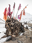 Ibex horns, gifts of hunters to bring good luck, adorn the mazar of Khoja Big Ali in Langar.<br /> Offerings of fabrics adorn a mazar in the Wakhan near Langar. Wakhis attach a lot of importance to such shrines – the burial place of a saint – mixing pre-islamic rites to their Ismaili belief.<br /> Trekking back down from the Little Pamir, with yak caravan, over the frozen Wakhan river.