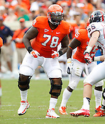 Virginia Cavaliers offensive tackle Morgan Moses (78) prepares to block Richmond Spiders defensive lineman Justin Williamson (55)  during the first half of the NCAA football game Saturday September, 1, 2012 at Scott Stadium in Charlottesville, Va.