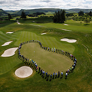 The 18th Green at Gleneagles. 100 days till the Ryder Cup and 100 people chip onto the 18th to celebrate. . Picture Robert Perry 16th June 2014<br /> <br /> Must credit photo to Robert Perry<br /> FEE PAYABLE FOR REPRO USE<br /> FEE PAYABLE FOR ALL INTERNET USE<br /> www.robertperry.co.uk<br /> NB -This image is not to be distributed without the prior consent of the copyright holder.<br /> in using this image you agree to abide by terms and conditions as stated in this caption.<br /> All monies payable to Robert Perry<br /> <br /> (PLEASE DO NOT REMOVE THIS CAPTION)<br /> This image is intended for Editorial use (e.g. news). Any commercial or promotional use requires additional clearance. <br /> Copyright 2014 All rights protected.<br /> first use only<br /> contact details<br /> Robert Perry     <br /> 07702 631 477<br /> robertperryphotos@gmail.com<br /> no internet usage without prior consent.         <br /> Robert Perry reserves the right to pursue unauthorised use of this image . If you violate my intellectual property you may be liable for  damages, loss of income, and profits you derive from the use of this image.