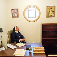 Mother Magda Garcia takes a seat in her new office at Sisters of Our Lady of Guadalupe and St. Joseph, and the sisters' newly remodeled convent, chapel and headquarters moved to the former Diocese of Gallup's chancery building in Gallup Tuesday.