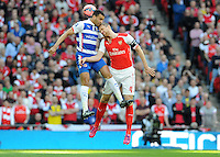 Reading's Hal Robson-Kanu and Arsenal's Per Mertesacker challenage for the header <br /> <br /> Photographer Ian Cook/CameraSport<br /> <br /> Football - The FA Cup Semi-Final - Reading v Arsenal - Saturday 18th April 2015 - Wembley - London<br /> <br /> © CameraSport - 43 Linden Ave. Countesthorpe. Leicester. England. LE8 5PG - Tel: +44 (0) 116 277 4147 - admin@camerasport.com - www.camerasport.com