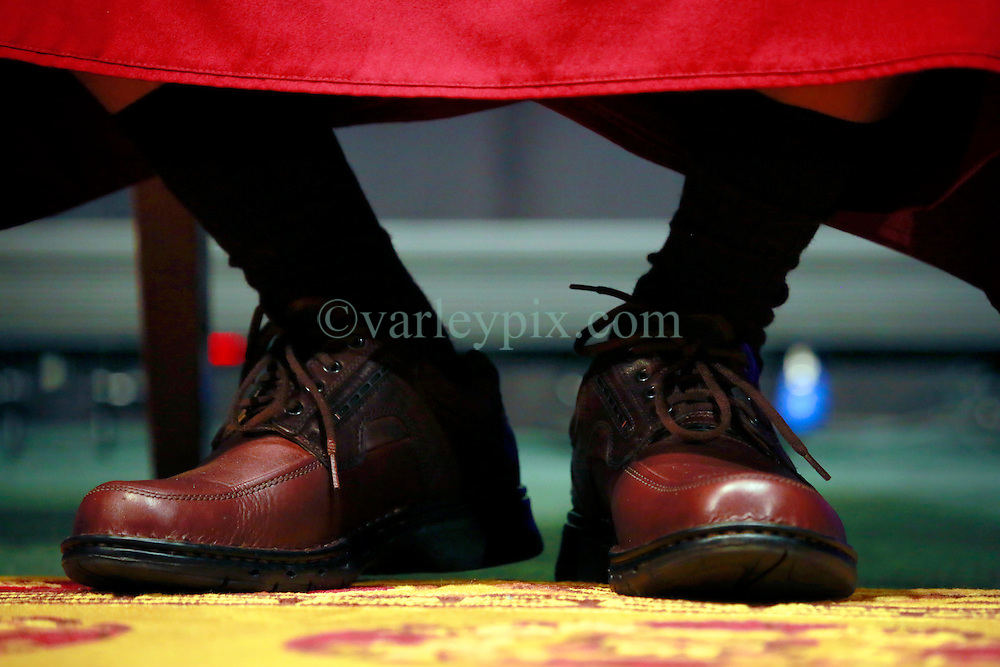17 May 2013. New Orleans, Louisiana,  USA. .His Holiness the 14th Dalai Lama in New Orleans for the 'Resiliance - Strength through Compassion and Connection' conference. .The Dalai Lama's shoes..Photo; Charlie Varley.