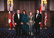 President Ronald Reagan and First Lady Nancy Reagan with Prime Minister Brian Mulroney and  wife Mila Mulroney pose before a gala in the Grand  Theater de Quebec during a state visit to Canada on March 3, 1985<br /><br />Photograph by Dennis Brack
